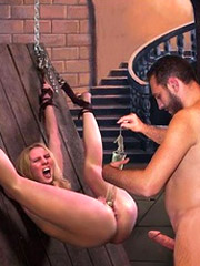 Two chained slaves get their bodies whipped!
