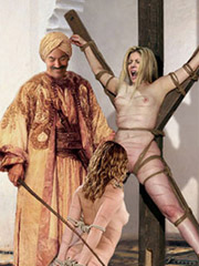 Slave girl hanged and her pussi is tortured by the chain!