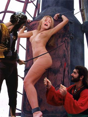 The men laugh, while the naked beauty struggles in her bonds!
