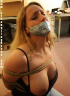 Gag taped blonde chick in jeans gets hogtied and dropped facedown to the floor