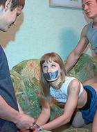 Gagballed and bound slave cutie satisfies forbidden dp fantasies of her capturers.