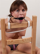 Brunette slave chick looks enthusiastic about bondage and rough sex while being whipped.