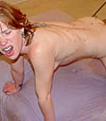 Blonde virgin in a tight ball gagg and securely bound in spreader bar and with neck bar