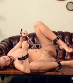 Chick enslaved and roped sucks cock before guy fucks her with cock and vibrator