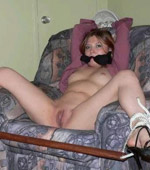 Blonde whore in stockings is tied up and thrown in a corner