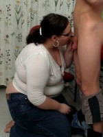 Fat lady sucks guy's cock before he lays her down to fuck her hard to cum