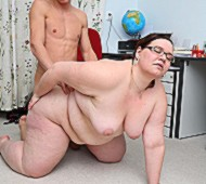 Fat teacher gets task to fuck student and she sucks cock before fucking on floor