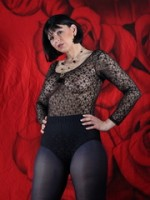 See the pierced nipple of bombshell wearing a black lace leotard and sheer black hosiery.