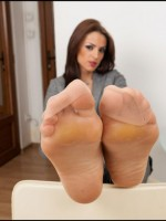 Alluring beauty teasing with her wide meaty soles
