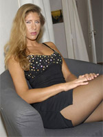 Jennifer in ripped open pantyhose tied on table spread legs