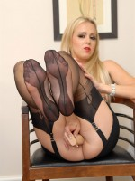 Mature blonde milf in black nylons and on high heels pleasing her wet pussy with thick dildo.
