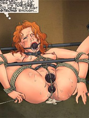 Restrained redhead slave babe gets gag balled and both her holes stuffed with dildos.