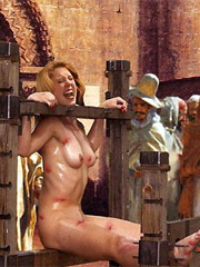 Two cute slaves with perfect boobs are inspected while being sold on the slave market.