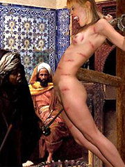 Slave girl crucified in the desert and spanked by her cruel master!