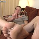 Hot looking guy displaying his gorgeously formed feet.