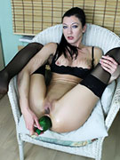 Ass fuck loving chick in black stocking dildoin her ass hole with bottle and lollies.