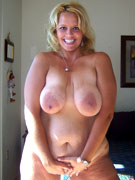 Plump chick with a cute face shows off her amazing big jugs and cute pussy