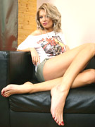 Slutty blonde shows her long legs and slender feet with long suckable toes