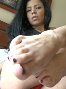 New - kitty shows her french pedicured toes