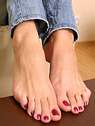 Brunette with red painted toenails