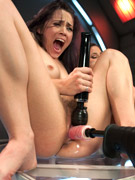 Two cute horny girls squirt and moan as they get fucked hard and fast by machines