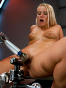Pretty chick plays with big sex toys and gets banged by auto machines to orgasms