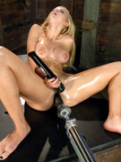 Hard sybian fucking in a locker room