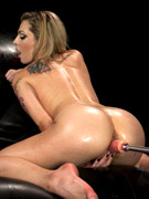 Gag-balled busty brunette pounded badly with a fucking machine