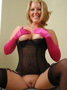 Sexy blonde housewife in black seethrough lingerie flashing her goods.