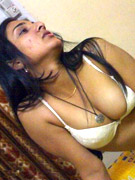 Horny indian cutie taking off her miniskirt and black panties just to show her shaved twat.