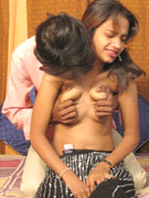 Indian milf with glasses squeezes huge tits