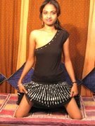Pigtailed indian teen girl rubbing her muff topless