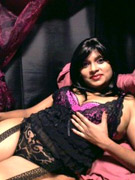 Divya in sexy black lingerie posing on camera