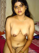 Young indian girl with small tits fingering on bed