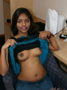 Indian in red lingerie spreading on