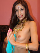 Plump amateur indian chick palying with her huge melons at home.