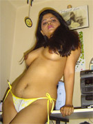 Indian hairy pussy milf posing in her sexy bikini on the beach.