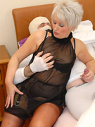 Sex starving granny in fishnet stockings pleasing black and white cocks at the same time.