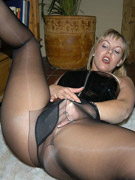 Fantastic kyla in crotchless pantyhose gets her legs and hands roped on the sofa.