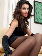 """breathtaking brunette in black top, white miniskirt and white pantyhose. """
