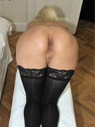 Redhead mature milf in black dress nad nylons gets her ass hole fingered and pussy banged hard.