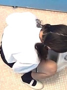 Horny black haired babes getting stalked in the toilet.