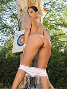 Sexy babe eve angel poses naked outdoors with bow