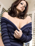 Stunning busty brunette, nikki nova, strips out of her sexy striped sweater showing off her amazing tits and body, and poses naked in the livingroom!