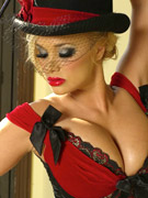 Shyla wears a sexy veil and top hat in this erotic striptease.
