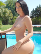 Nude posing by pool