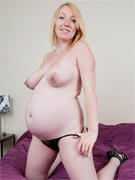Pregnant mature blonde spreads on a chair playing with her wet pussy and lovely boobs