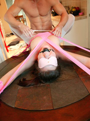 Tied up and wrapped in film slave girl gets spanked and rimmed badly till her master cummed onto her ass