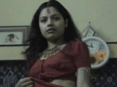 Very hot indian housewife in a red sari preparing for sex