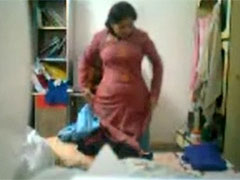 Pretty indian mom gets undressed